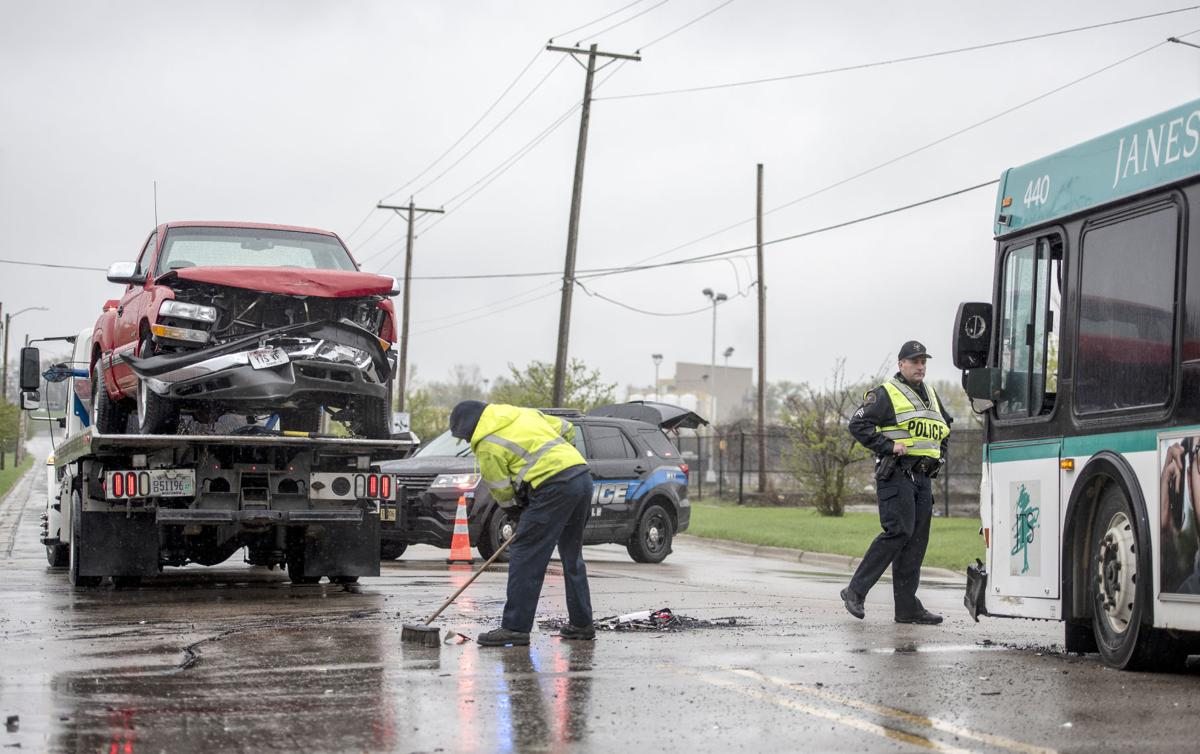 Three hurt when cars, bus collide | Local News | gazettextra com
