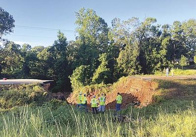 Two lives claimed in tragic highway washout