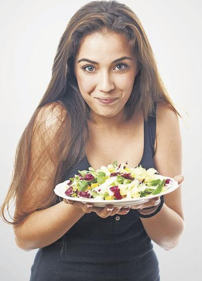 portrait of pretty young woman with a salad