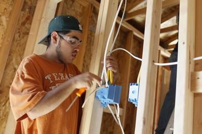 Gillette College students work on Habitat for Humanity house
