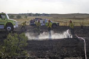 Arson damages field near YES House
