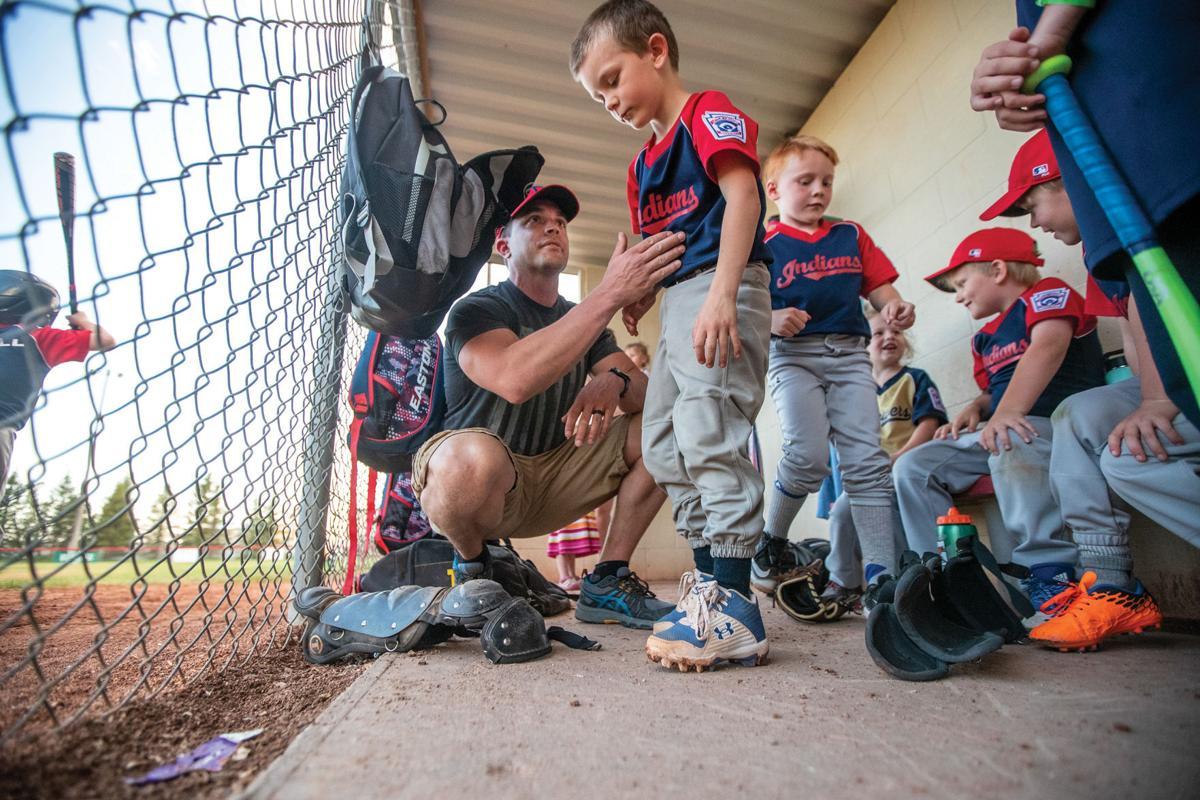 Law enforcement pair coach their sons in little league baseball