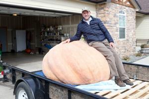 Cheyenne man breaks state record with 1,491-pound pumpkin