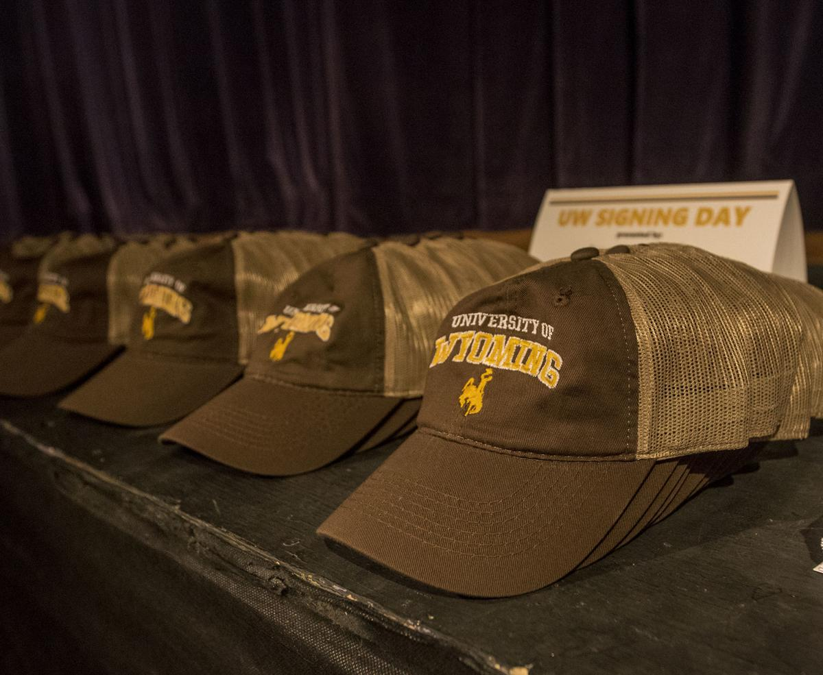 Brown and gold cookies, hats and balloons mark UW signing