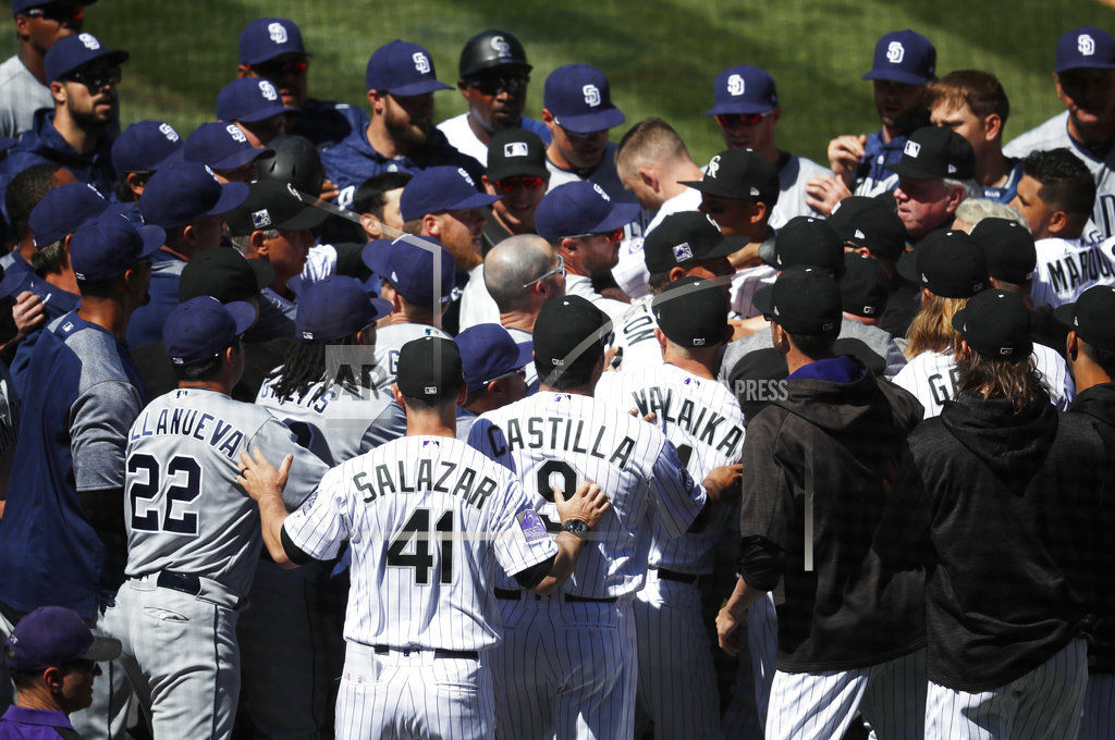 arenado charges mound swings away rockies and padres brawl