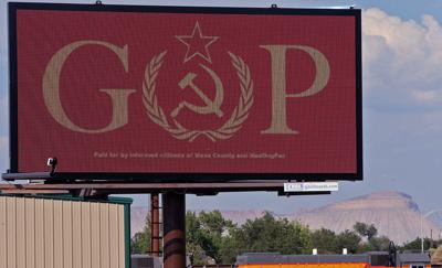 Local billboards feature GOP with Soviet hammer and sickle
