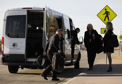 Shuttle services pay fees to airport