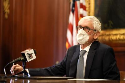Evers_Electoral_College_wearing_mask_AP_FILE_2020