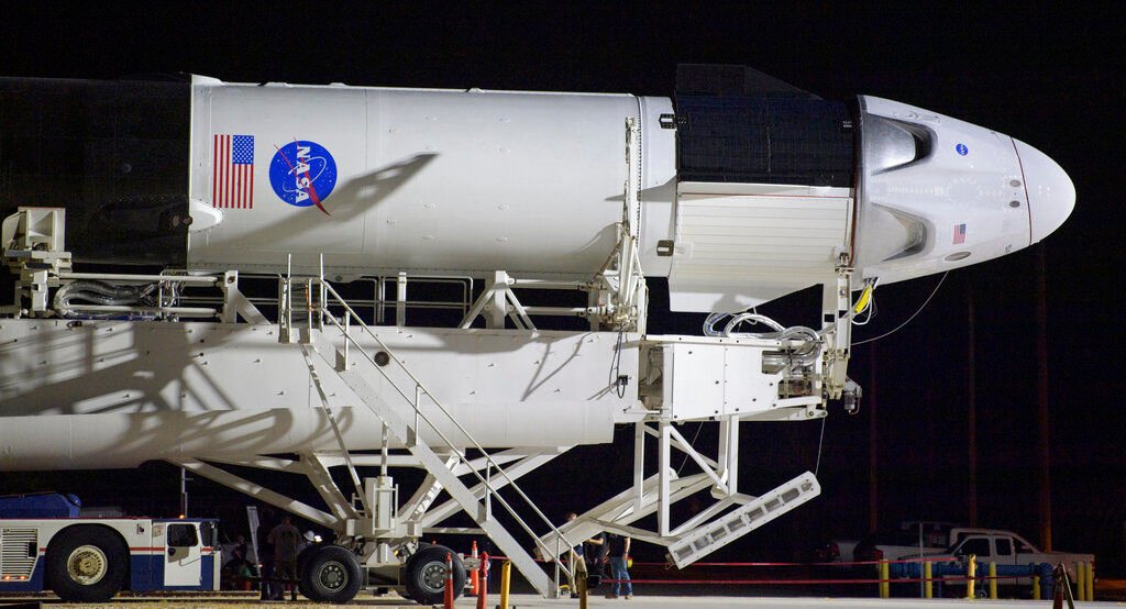 NASA astronauts go back to the future with capsule launch ...