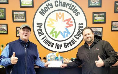 Beer Capitol and Modelo raise $7,500 for Mel's Charities