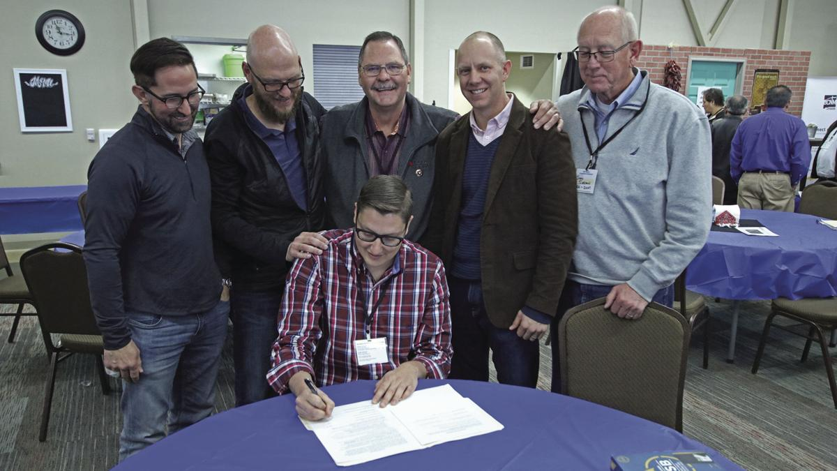 Hickman Signs Agreement