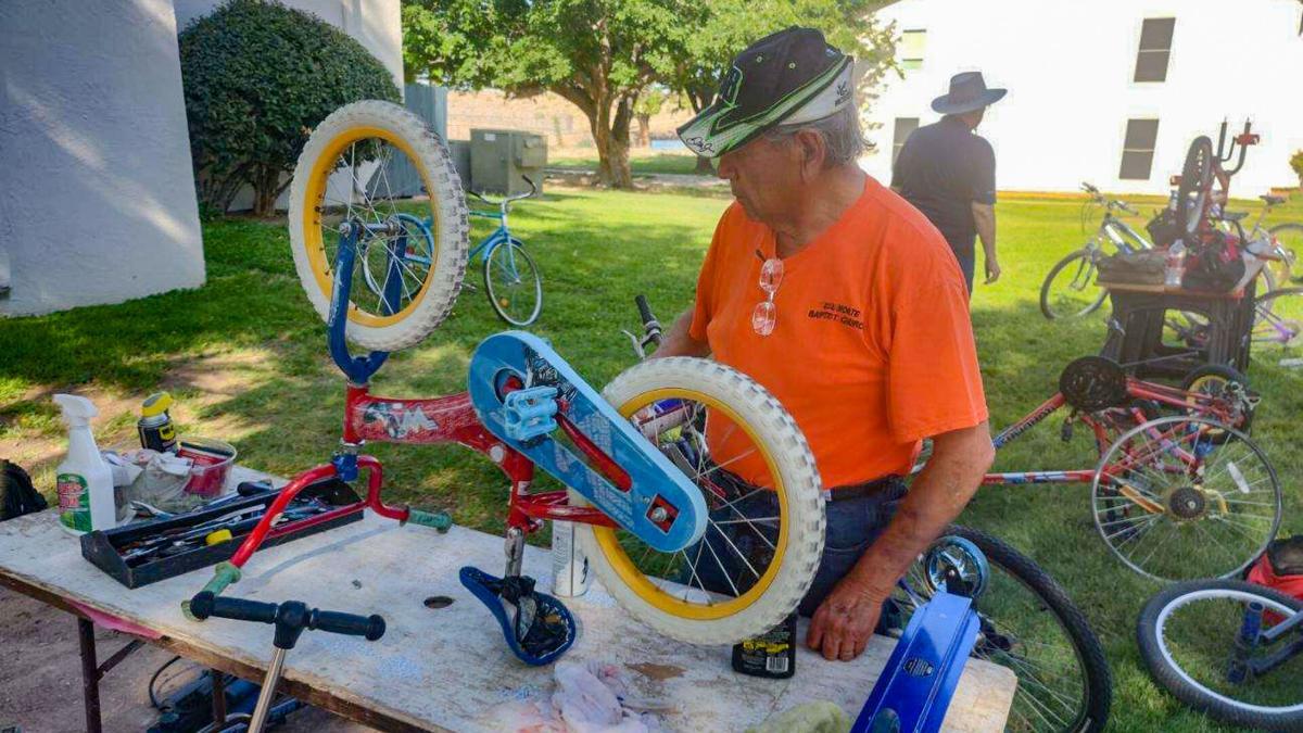 Joe Sandoval Repairing Bike