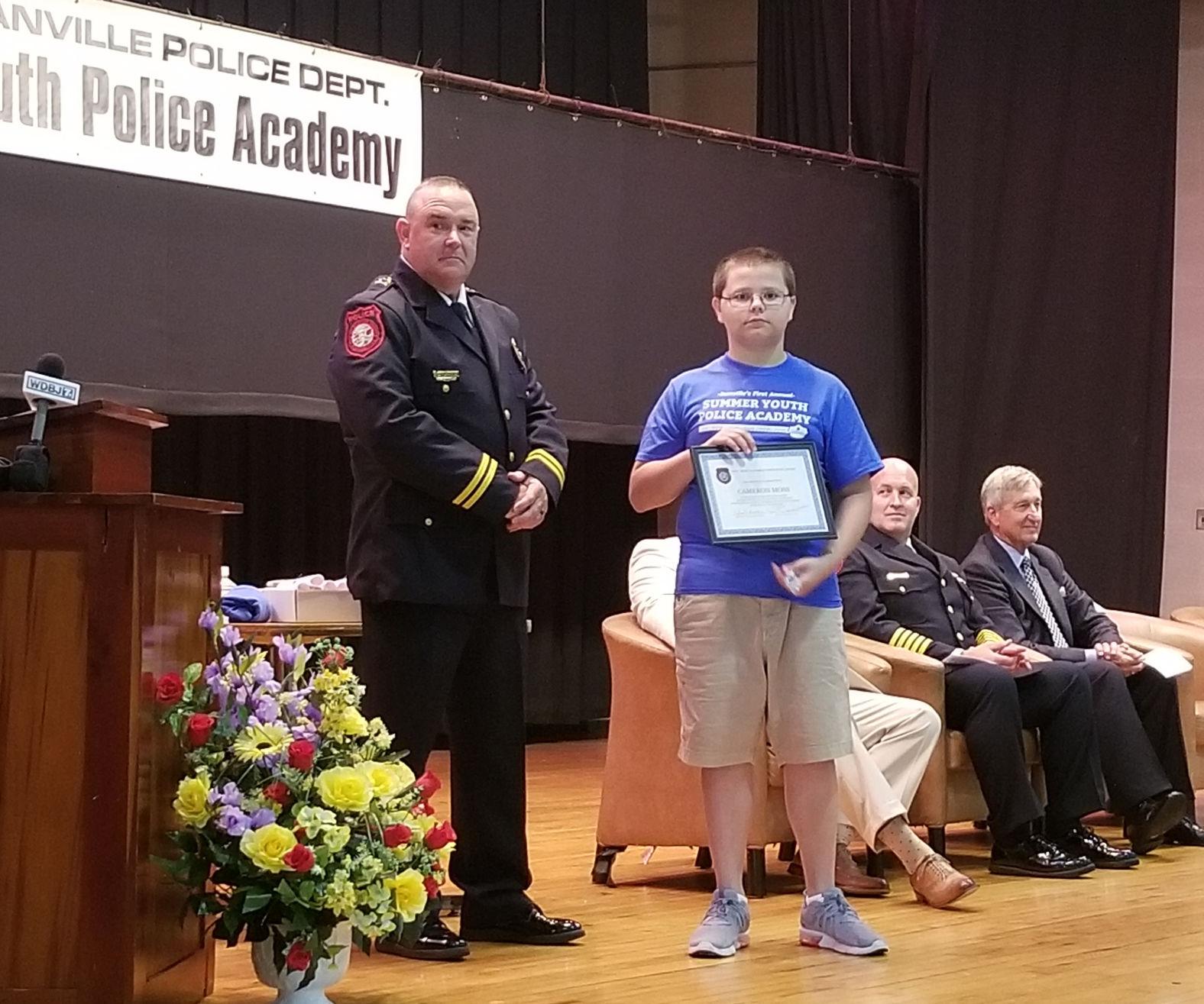 GRAD Dozens graduate first ever Youth Police Academy