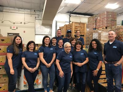 Attorneys, staff of Clement Wheatley help at God's Storehouse