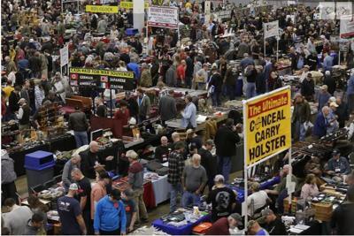 Firearm enthusiasts attended a gun show at Richmond Raceway