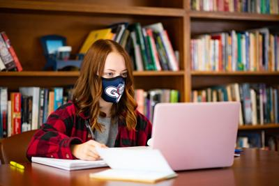 Keeping your workspace clear of distractions like your phone or a TV is vital to staying focused during online classes.
