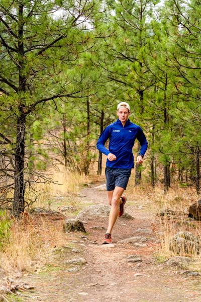 Patrick Donoghue goes trail running along the Spokane river at the Military Cemetery trailhead.