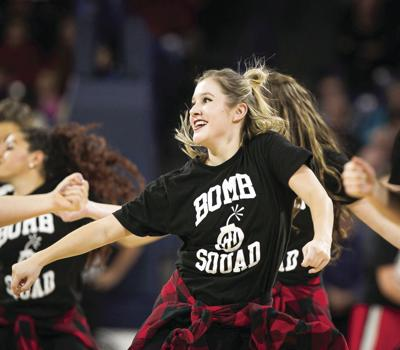 Emily Marchel performs with Bomb Squad for the Kennel during a media timeout. Due to COVID-19, Bomb Squad has had to adjust drastically.