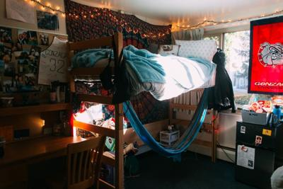A Gonzaga dorm decorated with lights, pictures and a hammock.