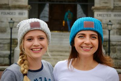 b3edaef756104 Audrey King (right) and Megan Chucka are members of the Love Your Melon  campus crew. Love Your Melon is a hat company whose proceeds go to cancer  research.