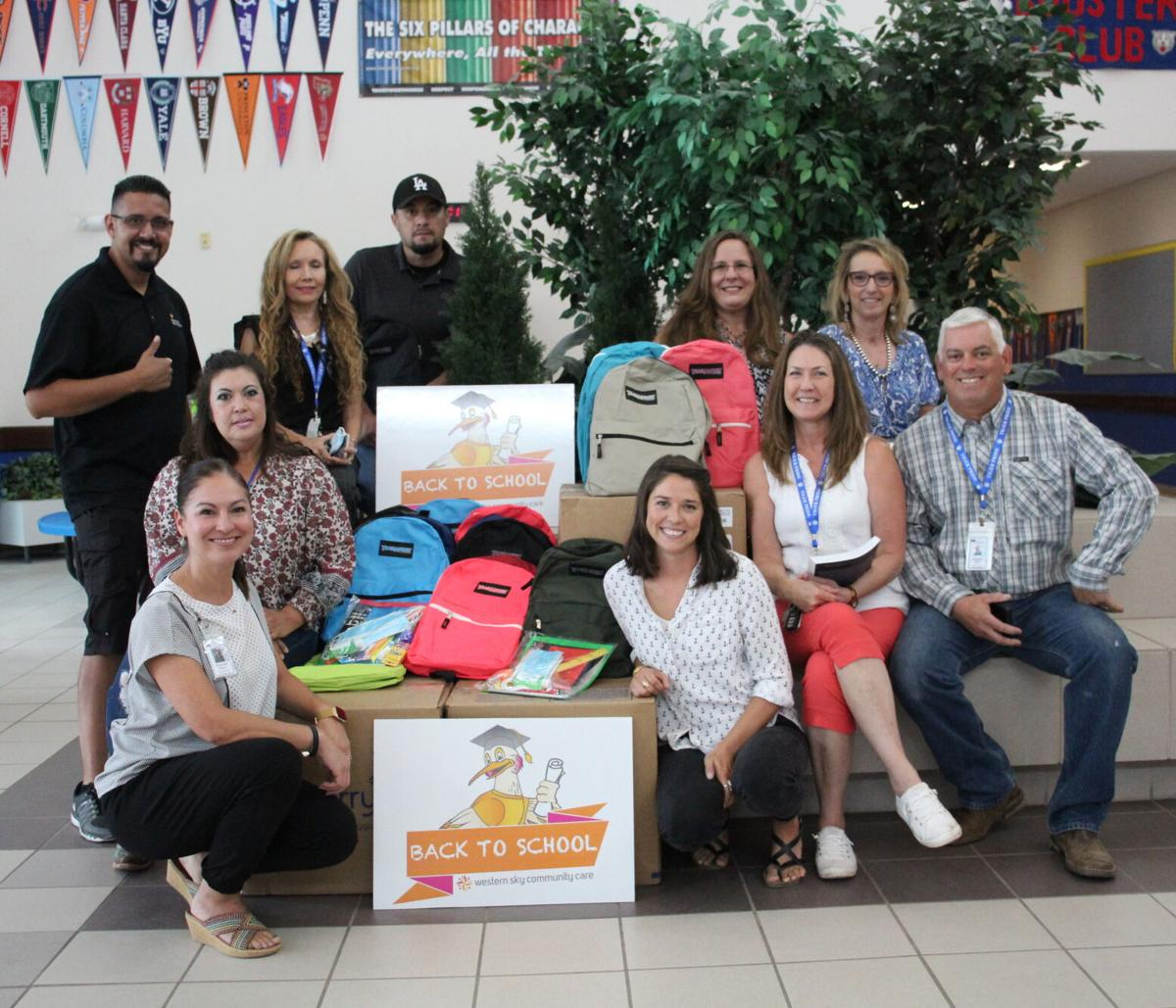 Schools Receive Welcome Donations Of Backpack And Supplies