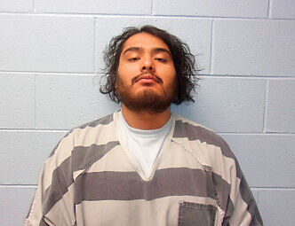 Man charged after running over woman with truck