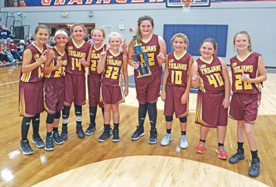 Lady Trojans take title in county tournament