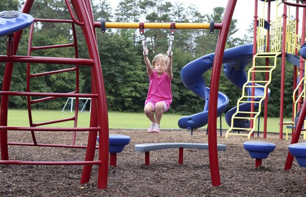 Community puts together new playground structure