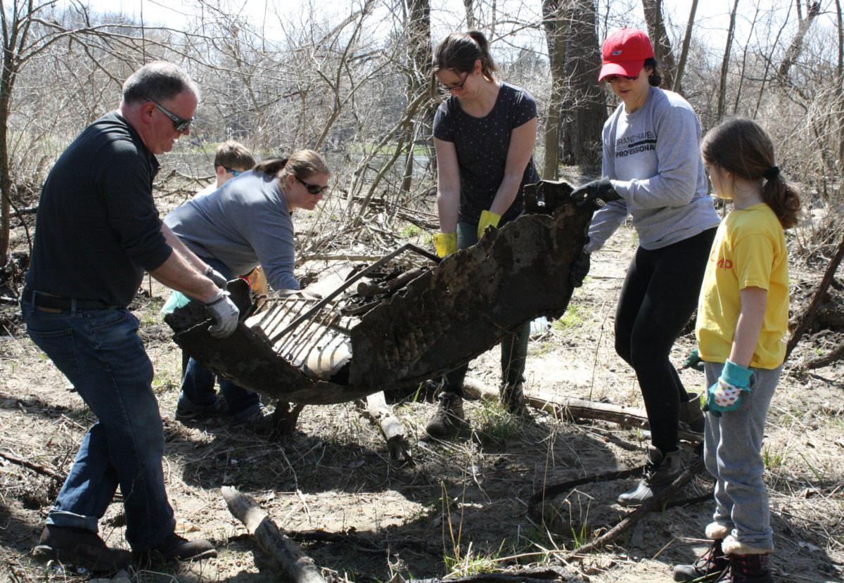 Volunteers clean up everything from toilets to wood-fired cook stoves from river banks