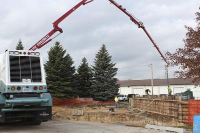 Crews work on Sluka Field building