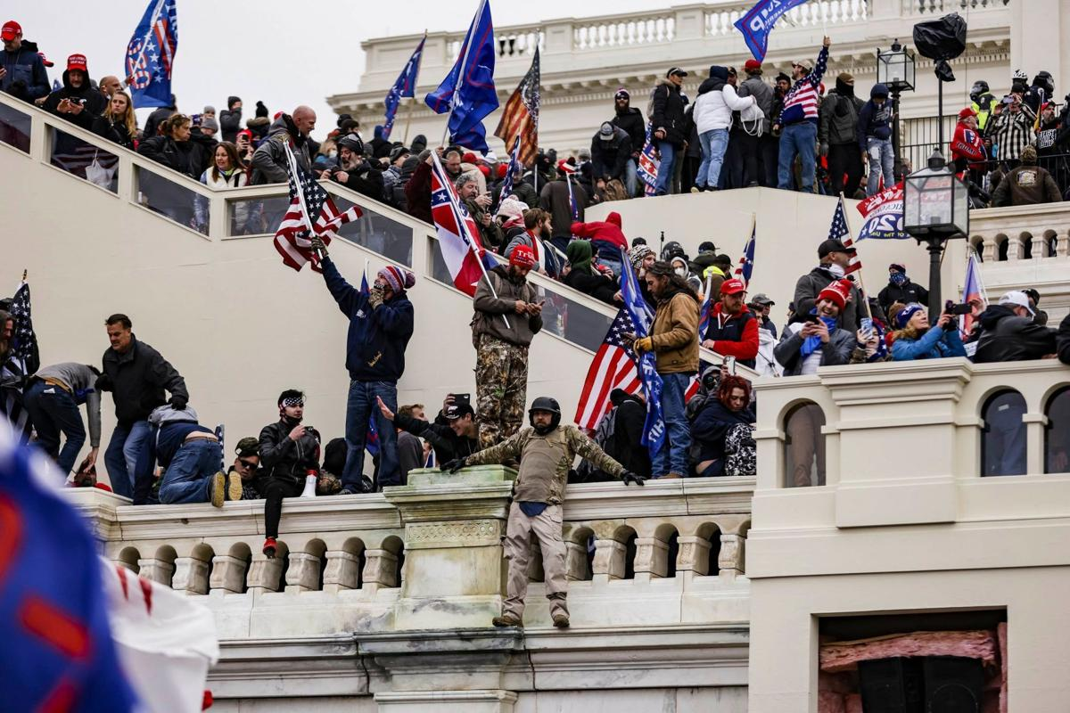 US-NEWS-AS-TRUMP-RIOTERS-BREACHED-CAPITOL-2-PM.jpg