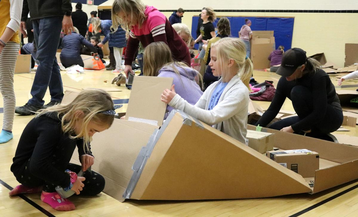 Families use creativity to build cardboard sleds