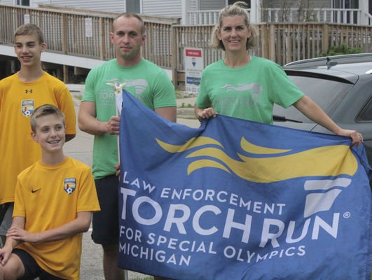 Torch runners beat storm back to the finish line