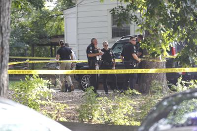 911 call: West Florida Street homicide victim covered in