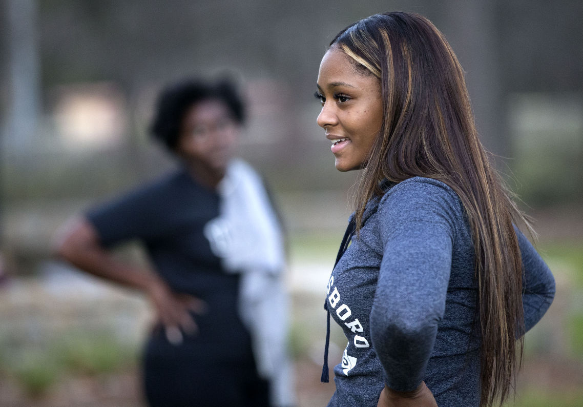 UNCG senior and professional bodybuilder Jasmine Williams leads a group workout at the Greensboro Arboretum