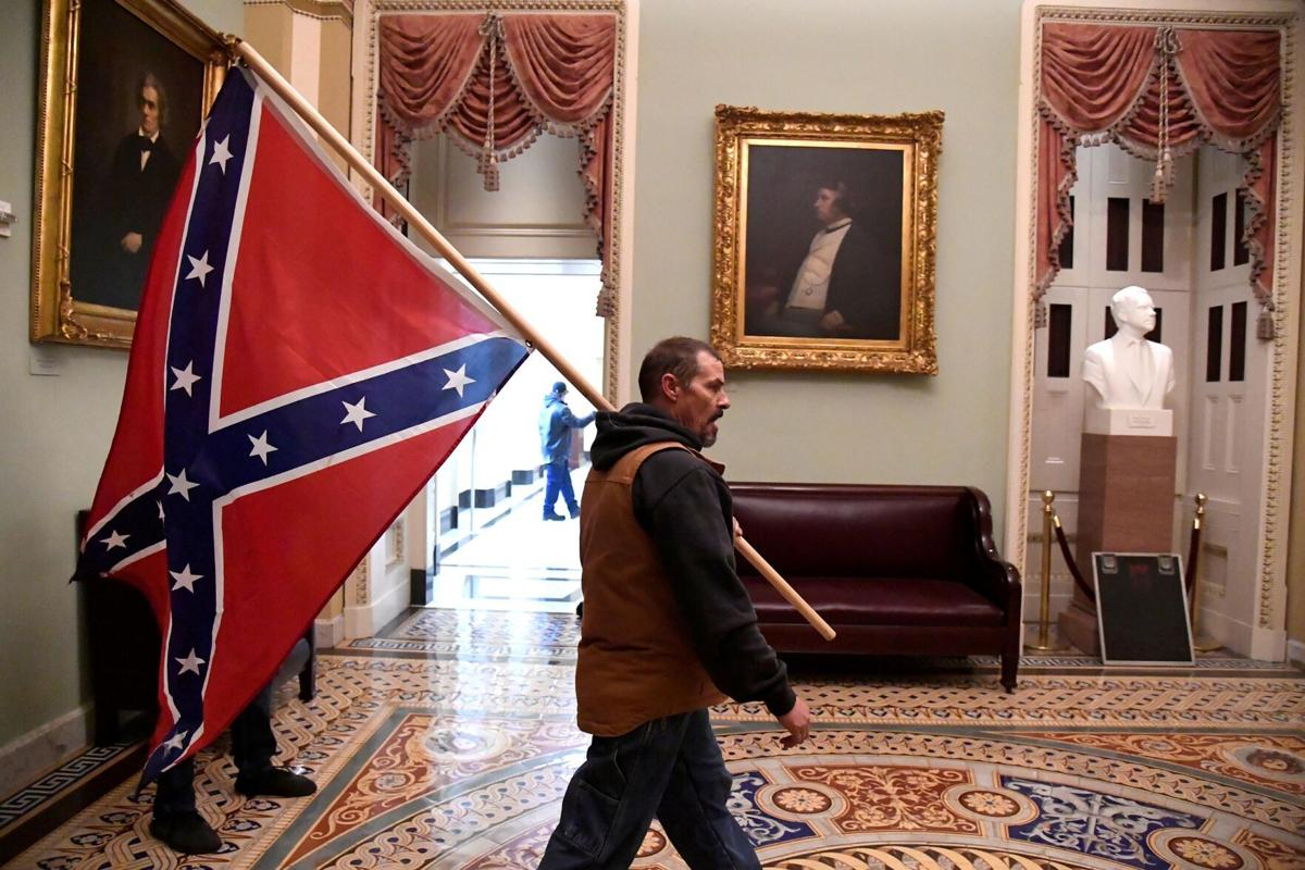 Man carrying Confederate flag inside US Capitol during riot arrested in Delaware (copy)