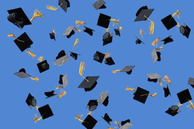 Graduation caps thrown into air college commencement generic