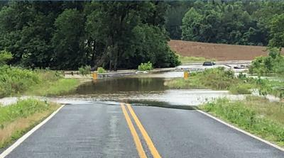 Guilford County escaped the heavy rainfall that flooded the foothills, but emergency officials still had to rescue drivers and a dog