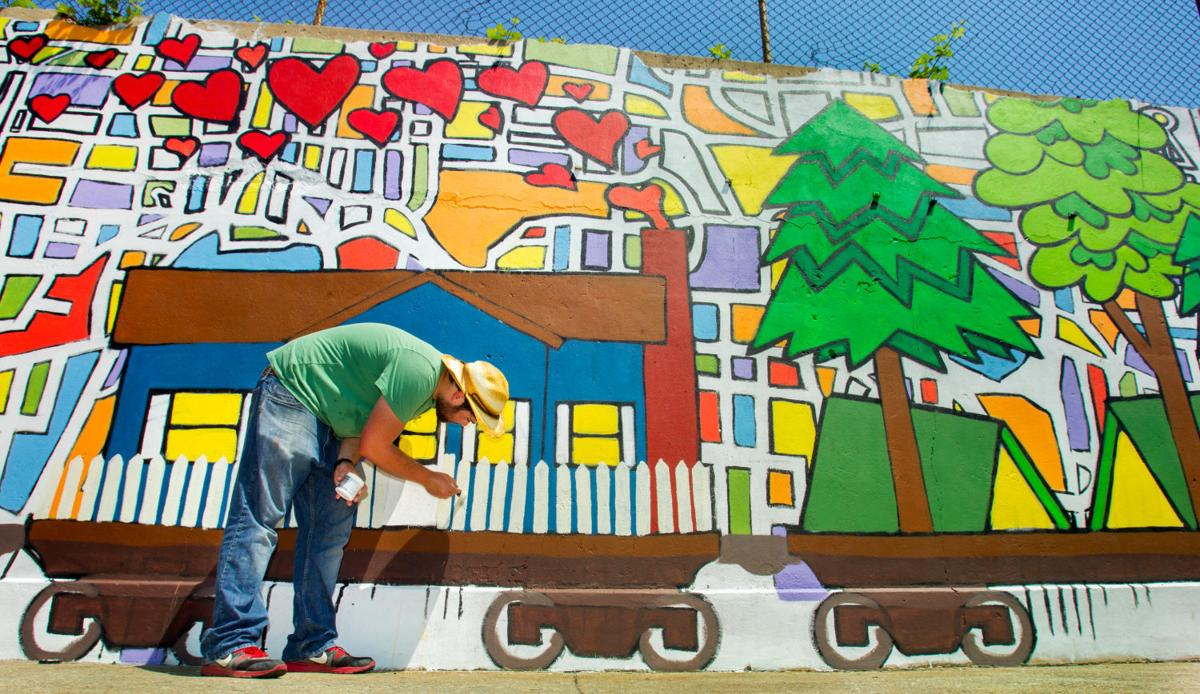 susan ladd mural project wants your love letters to greensboro irc mural 051913 main