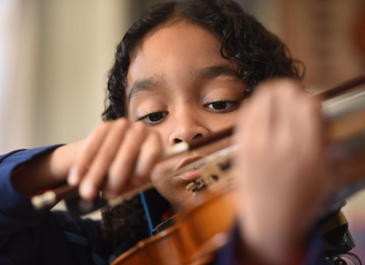 9-year-old violin prodigy defeats strokes, paralysis