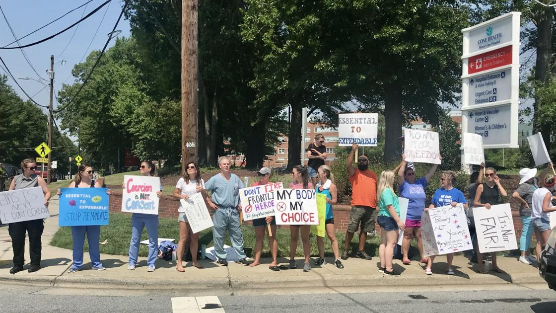'My body, my choice': Crowd protests Cone Health's COVID-19 vaccine requirement outside Moses Cone Hospital in Greensboro