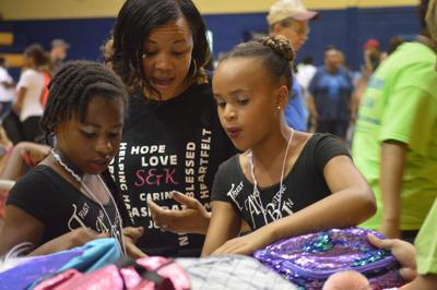 Local non-profit hands out more than 1,300 free backpacks