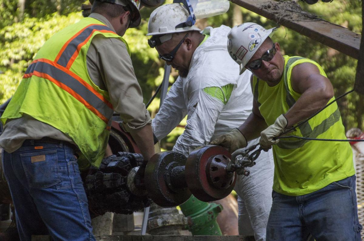 Workers perform maintenance on a natural gas pipeline.