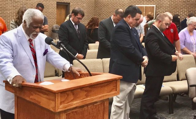 Rev. Thurman Echols gives the invocation at Henry County School Board meeting