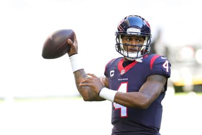 Deshaun Watson of the Houston Texans in action against the Tennessee Titans on Jan. 3, 2021 at NRG Stadium in Houston, Texas.