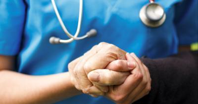 Doctor helping patient (copy) (copy)