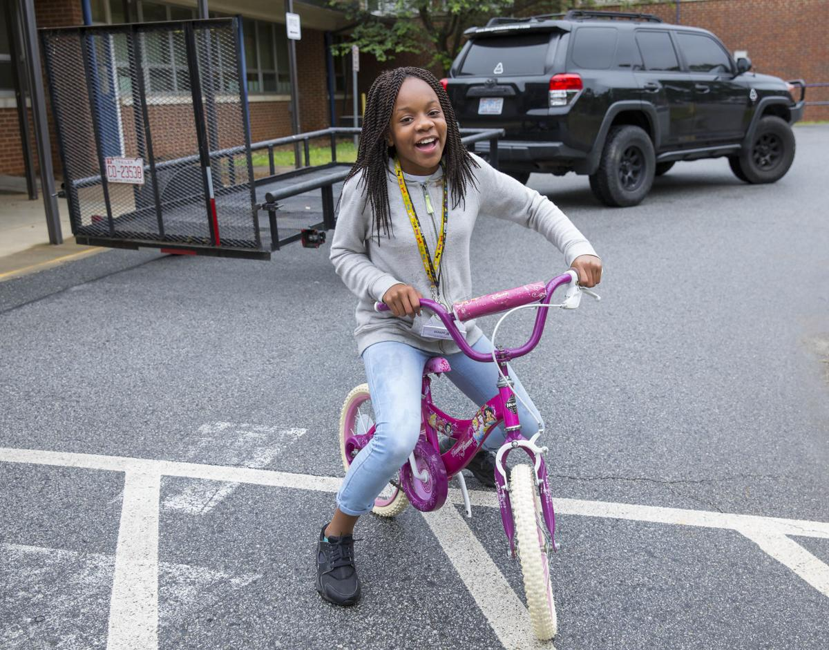 Students collect bikes for Ghana