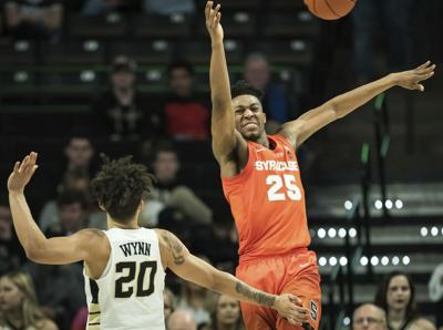 Syracuse guard Tyus Battle loses control of the ball while pressured by  Wake Forest guard Michael Wynn. 0df433945