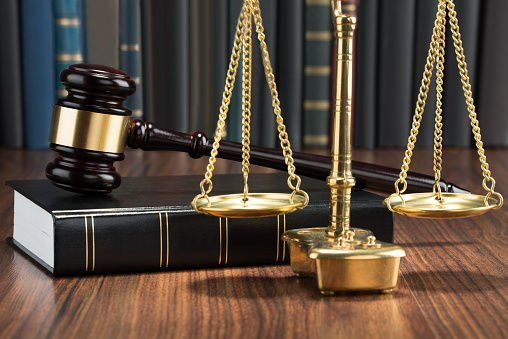 Gavel On Book With Golden Scale WEB ONLY