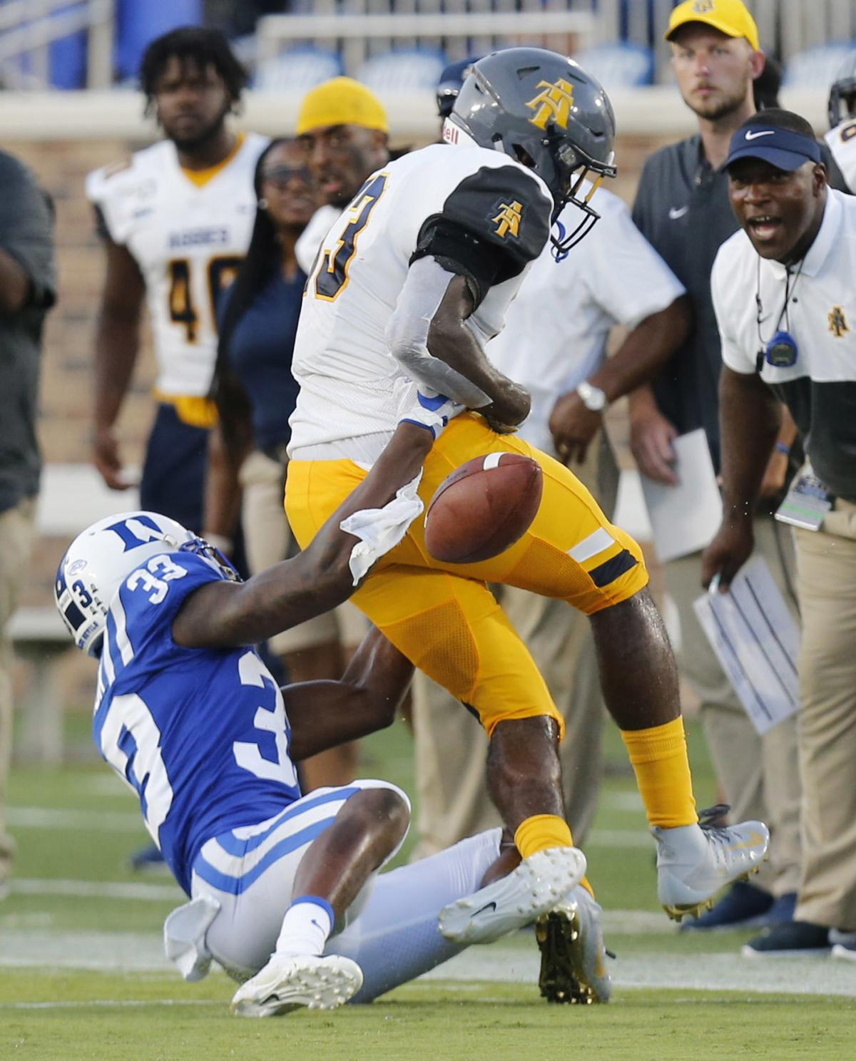 NC A&T loses 45-13, worn down by QB Quentin Harris and